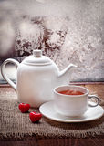 Tea cup and  teapot with red hearts   in winter frosty day Stock Photo