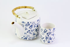 Tea cup with teapot on white background Stock Image