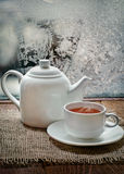 Tea cup and  teapot with   in winter frosty day Stock Photography
