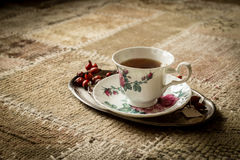 Tea cup on tray, vintage style Stock Images