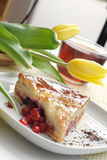 Tea cup, tulips and piece of an apple pie Stock Images