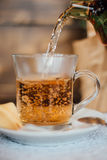 Tea in cup. Turkish tea being poured into glass cup Royalty Free Stock Photos