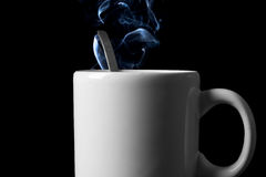Tea cup with vapor trail Stock Images