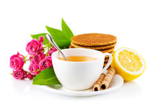Tea in cup with waffles and bouquet roses Stock Photos
