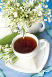 Tea in a cup of white flowers Royalty Free Stock Photography