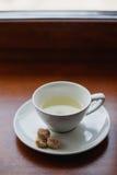 Tea cup, white mug, saucer, sugar cane Royalty Free Stock Photo
