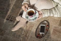 Tea cup in woman hands Royalty Free Stock Images