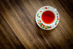 Tea cup on wooden background Stock Photos