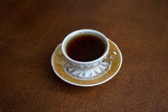 Tea cup. On wooden desk Stock Image