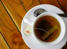 Tea cup on the wooden table. At local coffee shop in Mauritius Island Royalty Free Stock Photos