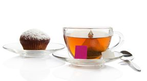 Tea, cupcake on a saucer Stock Photos
