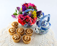 Tea cupcakes and pots Stock Image