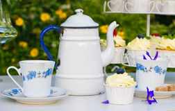 Tea with cupcakes in a vintage teapot Stock Image