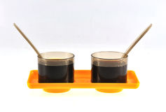 Tea cups. Twin cups of tea placed on an yellow tray Royalty Free Stock Photos