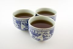 Tea cups. Three cups full of chinese tea Stock Photography