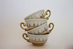 Tea cups. Golden, vintage look Stock Photos