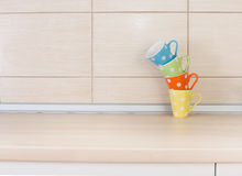 Tea cups on kitchen countertop Royalty Free Stock Images