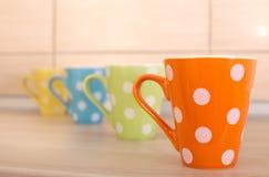 Tea cups on kitchen countertop Stock Photo