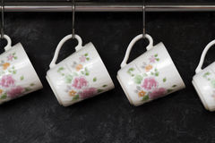 Tea cups on the kitchen wall Royalty Free Stock Photo