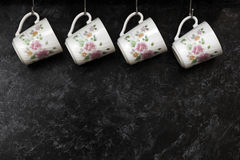 Tea cups on the kitchen wall Stock Image
