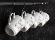 Tea cups on the kitchen wall Royalty Free Stock Images
