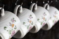 Tea cups on the kitchen wall Royalty Free Stock Photos