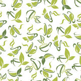 Tea cups with leaves seamless pattern background Royalty Free Stock Photos