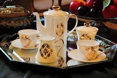 Tea cups with a pot Royalty Free Stock Photo
