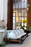 Tea cups on rack. Chinese tea cups on bamboo rack on table Stock Images