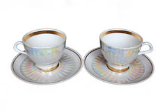 Tea cups and saucers isolated Royalty Free Stock Photos