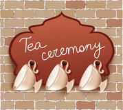 Tea cups with signboard Stock Photos