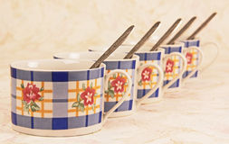 Tea cups with spoons. Royalty Free Stock Photo