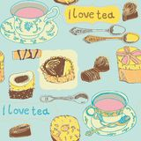 Tea cups, spoons and cookies Stock Photos