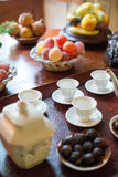 Tea, cups and sweets. Stock Photos