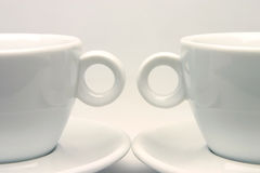 Tea cups symmetry. Two white cups of tea in a nice symmetry composition Royalty Free Stock Photos
