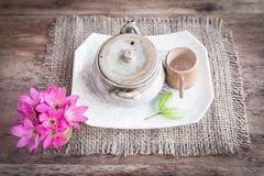 Tea cups with teapot on old wooden table Stock Images