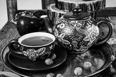 Tea cups with teapot on old wooden table Royalty Free Stock Photos