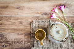 Tea cups with teapot on old wooden table. Royalty Free Stock Photo
