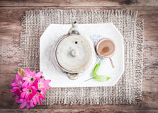 Tea cups with teapot on old wooden table. Stock Photo