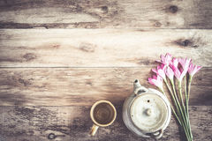 Tea cups with teapot on old wooden table. Royalty Free Stock Photography