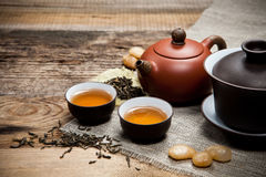 Tea cups with teapot on table Royalty Free Stock Image
