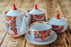 Tea cups with teapot on wooden table Royalty Free Stock Photos