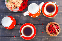 Tea cups top view. Tea time for party. Tea set red polka-dot, co Royalty Free Stock Photography