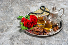 Tea, dates fruits, red rose flower, holy book quran and rosary. Islamic holidays decoration. Ramadan kareem. Eid mubarak. Oriental hospitality concept. Vintage Royalty Free Stock Photos