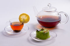 Tea with a delicious green dessert. Royalty Free Stock Images
