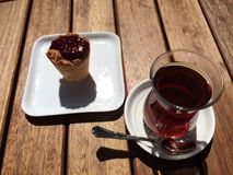 Tea and delisious coconut. Cupcake and turkish tea at nisantasi street Royalty Free Stock Photos