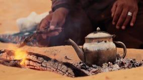 A tea in the desert, close up. Sahara man preparing a tea stock video footage