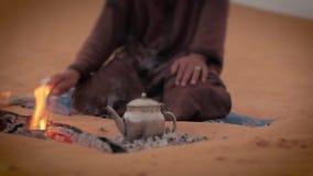 A tea in the desert, close up. Sahara man preparing a tea stock footage