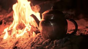 A tea in the desert by night, close up stock footage