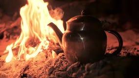 A tea in the desert by night, close up. Sahara man preparing a tea stock footage